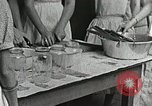Image of pickling demonstration Campbell County Tennessee USA, 1935, second 35 stock footage video 65675023120