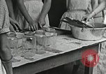 Image of pickling demonstration Campbell County Tennessee USA, 1935, second 36 stock footage video 65675023120