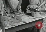 Image of pickling demonstration Campbell County Tennessee USA, 1935, second 37 stock footage video 65675023120