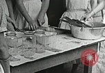 Image of pickling demonstration Campbell County Tennessee USA, 1935, second 38 stock footage video 65675023120