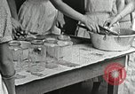 Image of pickling demonstration Campbell County Tennessee USA, 1935, second 40 stock footage video 65675023120