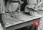 Image of pickling demonstration Campbell County Tennessee USA, 1935, second 41 stock footage video 65675023120