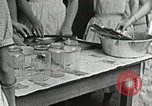 Image of pickling demonstration Campbell County Tennessee USA, 1935, second 43 stock footage video 65675023120