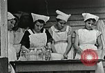 Image of pickling demonstration Campbell County Tennessee USA, 1935, second 62 stock footage video 65675023120