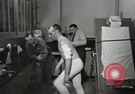 Image of NASA testing Hal Crandall for fitness Ohio United States USA, 1959, second 15 stock footage video 65675023415