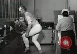Image of NASA testing Hal Crandall for fitness Ohio United States USA, 1959, second 21 stock footage video 65675023415