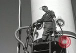Image of Redstone Missile being fueled from trucks New Mexico United States USA, 1960, second 41 stock footage video 65675023466