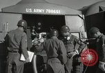 Image of Redstone Missile being fueled from trucks New Mexico United States USA, 1960, second 52 stock footage video 65675023466