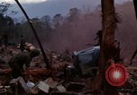 Image of Wrecked US Army UH-1H helicopter A Shau Valley Vietnam, 1968, second 2 stock footage video 65675026858