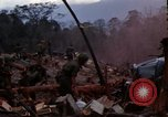 Image of Wrecked US Army UH-1H helicopter A Shau Valley Vietnam, 1968, second 4 stock footage video 65675026858