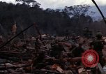 Image of Wrecked US Army UH-1H helicopter A Shau Valley Vietnam, 1968, second 7 stock footage video 65675026858