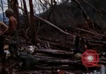 Image of Wrecked US Army UH-1H helicopter A Shau Valley Vietnam, 1968, second 12 stock footage video 65675026858