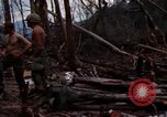 Image of Wrecked US Army UH-1H helicopter A Shau Valley Vietnam, 1968, second 13 stock footage video 65675026858