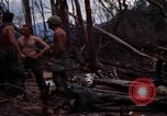 Image of Wrecked US Army UH-1H helicopter A Shau Valley Vietnam, 1968, second 14 stock footage video 65675026858