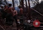 Image of Wrecked US Army UH-1H helicopter A Shau Valley Vietnam, 1968, second 15 stock footage video 65675026858