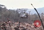 Image of Wrecked US Army UH-1H helicopter A Shau Valley Vietnam, 1968, second 16 stock footage video 65675026858