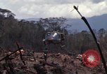 Image of Wrecked US Army UH-1H helicopter A Shau Valley Vietnam, 1968, second 17 stock footage video 65675026858