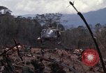 Image of Wrecked US Army UH-1H helicopter A Shau Valley Vietnam, 1968, second 18 stock footage video 65675026858