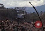 Image of Wrecked US Army UH-1H helicopter A Shau Valley Vietnam, 1968, second 19 stock footage video 65675026858