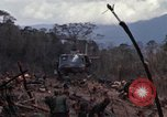 Image of Wrecked US Army UH-1H helicopter A Shau Valley Vietnam, 1968, second 20 stock footage video 65675026858