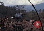Image of Wrecked US Army UH-1H helicopter A Shau Valley Vietnam, 1968, second 21 stock footage video 65675026858