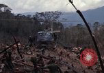 Image of Wrecked US Army UH-1H helicopter A Shau Valley Vietnam, 1968, second 22 stock footage video 65675026858