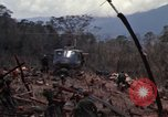 Image of Wrecked US Army UH-1H helicopter A Shau Valley Vietnam, 1968, second 23 stock footage video 65675026858