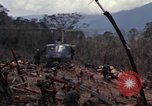 Image of Wrecked US Army UH-1H helicopter A Shau Valley Vietnam, 1968, second 24 stock footage video 65675026858