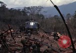 Image of Wrecked US Army UH-1H helicopter A Shau Valley Vietnam, 1968, second 25 stock footage video 65675026858