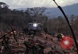 Image of Wrecked US Army UH-1H helicopter A Shau Valley Vietnam, 1968, second 26 stock footage video 65675026858