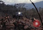 Image of Wrecked US Army UH-1H helicopter A Shau Valley Vietnam, 1968, second 27 stock footage video 65675026858
