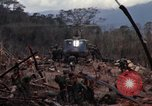 Image of Wrecked US Army UH-1H helicopter A Shau Valley Vietnam, 1968, second 28 stock footage video 65675026858
