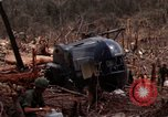 Image of Wrecked US Army UH-1H helicopter A Shau Valley Vietnam, 1968, second 29 stock footage video 65675026858