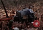 Image of Wrecked US Army UH-1H helicopter A Shau Valley Vietnam, 1968, second 30 stock footage video 65675026858