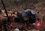 Image of Wrecked US Army UH-1H helicopter A Shau Valley Vietnam, 1968, second 31 stock footage video 65675026858