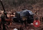 Image of Wrecked US Army UH-1H helicopter A Shau Valley Vietnam, 1968, second 32 stock footage video 65675026858