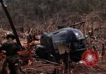 Image of Wrecked US Army UH-1H helicopter A Shau Valley Vietnam, 1968, second 34 stock footage video 65675026858
