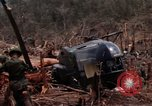 Image of Wrecked US Army UH-1H helicopter A Shau Valley Vietnam, 1968, second 35 stock footage video 65675026858