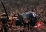 Image of Wrecked US Army UH-1H helicopter A Shau Valley Vietnam, 1968, second 36 stock footage video 65675026858