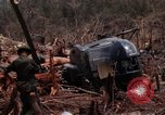 Image of Wrecked US Army UH-1H helicopter A Shau Valley Vietnam, 1968, second 37 stock footage video 65675026858