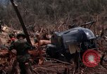 Image of Wrecked US Army UH-1H helicopter A Shau Valley Vietnam, 1968, second 38 stock footage video 65675026858
