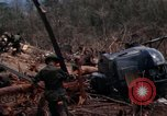 Image of Wrecked US Army UH-1H helicopter A Shau Valley Vietnam, 1968, second 39 stock footage video 65675026858