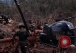 Image of Wrecked US Army UH-1H helicopter A Shau Valley Vietnam, 1968, second 40 stock footage video 65675026858