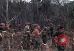Image of Wrecked US Army UH-1H helicopter A Shau Valley Vietnam, 1968, second 41 stock footage video 65675026858