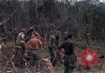 Image of Wrecked US Army UH-1H helicopter A Shau Valley Vietnam, 1968, second 42 stock footage video 65675026858
