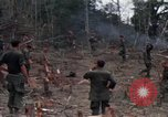 Image of Wrecked US Army UH-1H helicopter A Shau Valley Vietnam, 1968, second 45 stock footage video 65675026858