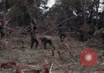 Image of Wrecked US Army UH-1H helicopter A Shau Valley Vietnam, 1968, second 50 stock footage video 65675026858