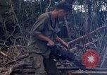 Image of Wrecked US Army UH-1H helicopter A Shau Valley Vietnam, 1968, second 54 stock footage video 65675026858
