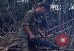 Image of Wrecked US Army UH-1H helicopter A Shau Valley Vietnam, 1968, second 55 stock footage video 65675026858