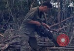 Image of Wrecked US Army UH-1H helicopter A Shau Valley Vietnam, 1968, second 56 stock footage video 65675026858